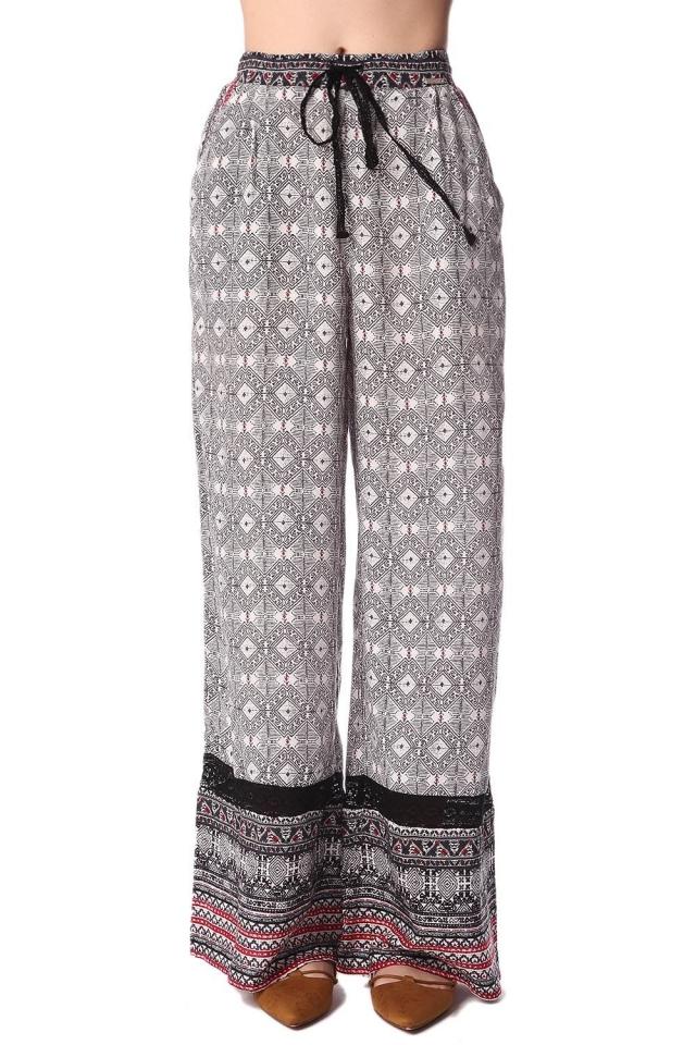 Pantalones de pernera amplia con estampado etnico y detalle de puntilla