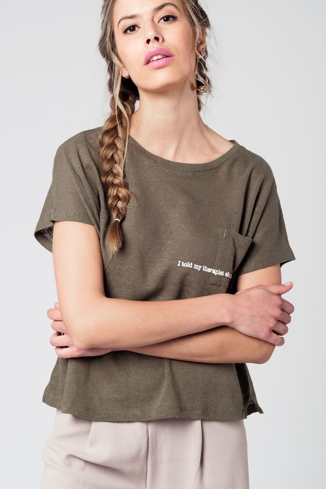 Khaki t-shirt with text and pocket at the front