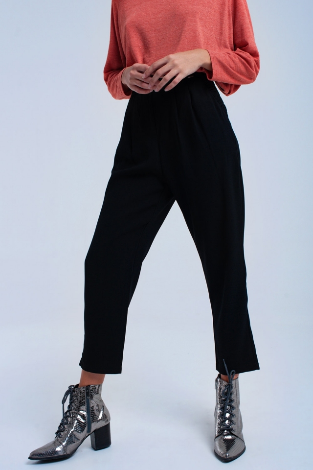 Black trousers with ruffles and laces