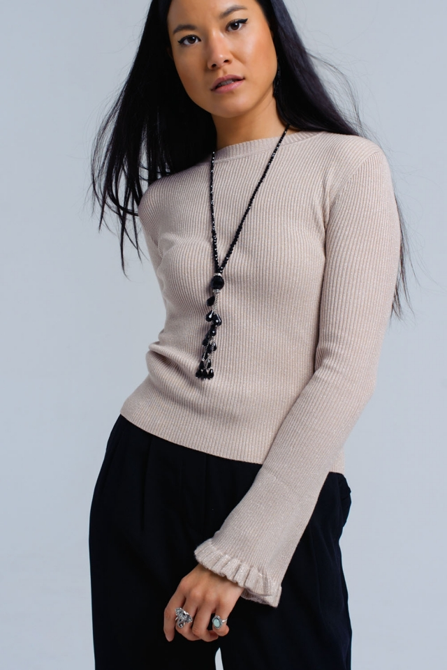 Pink ribbed sweater with ruffle