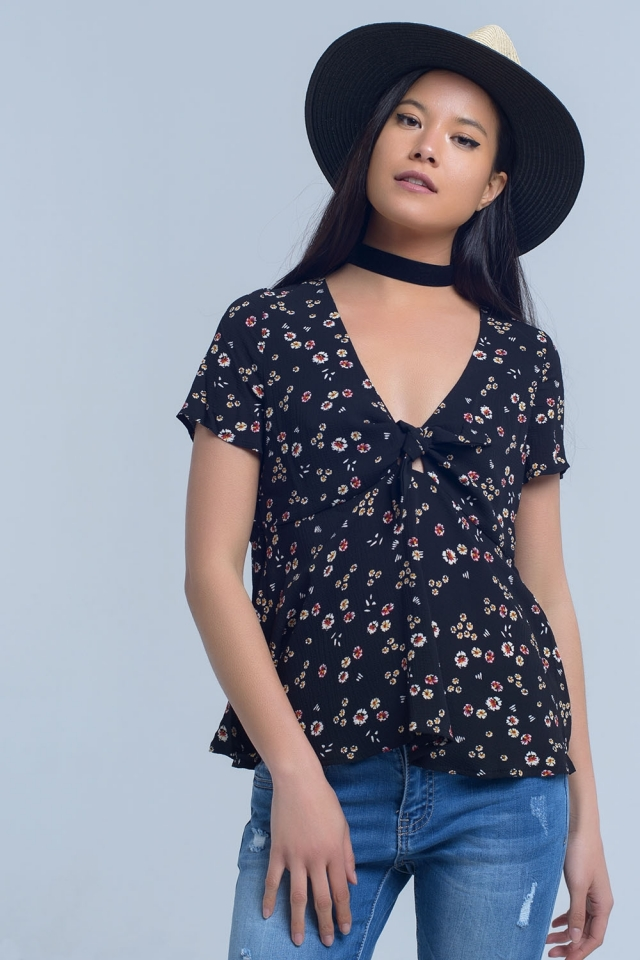 Black top with floral print