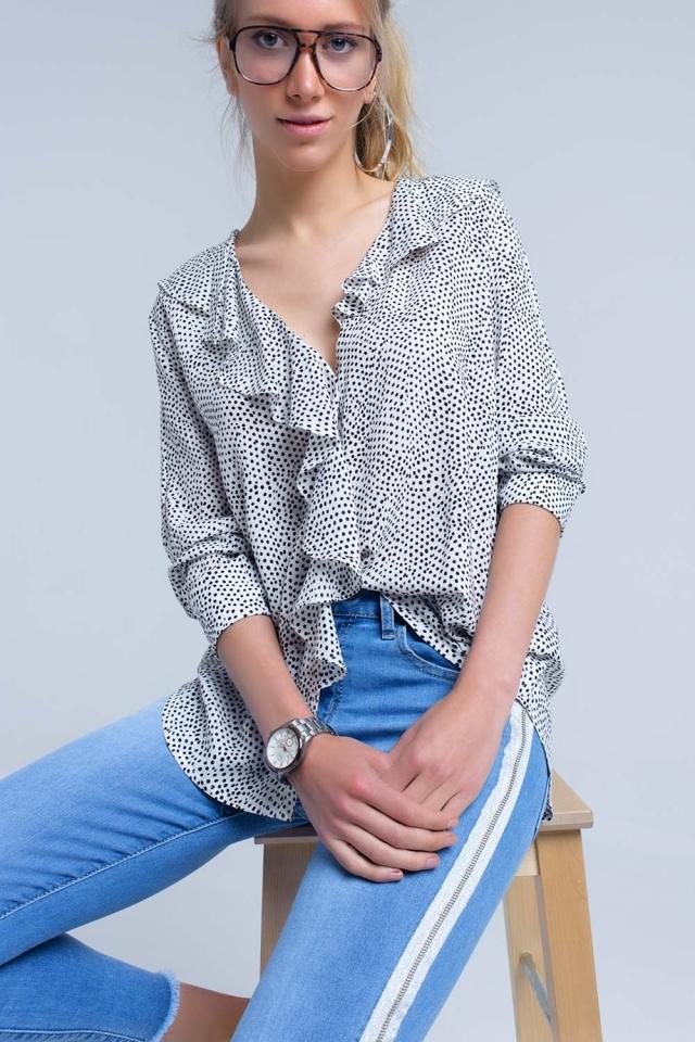 White polka dot shirt with ruffle detail at front