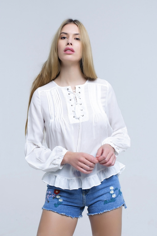 White lace up top with ruffle detail