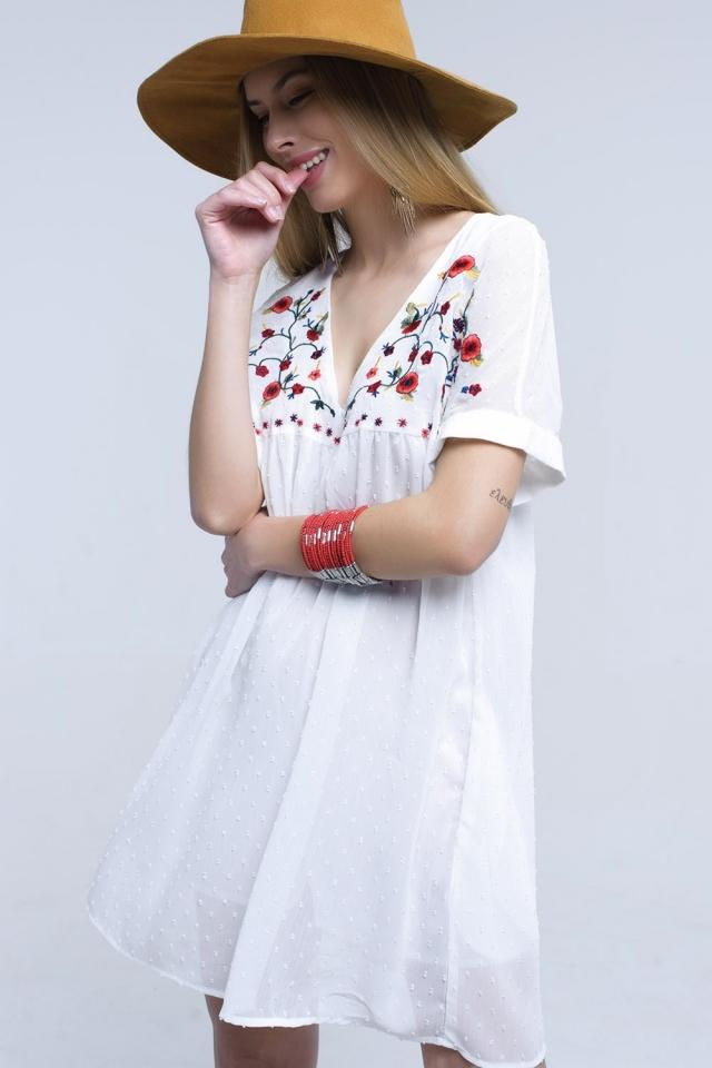 White midi dress with embroidered design