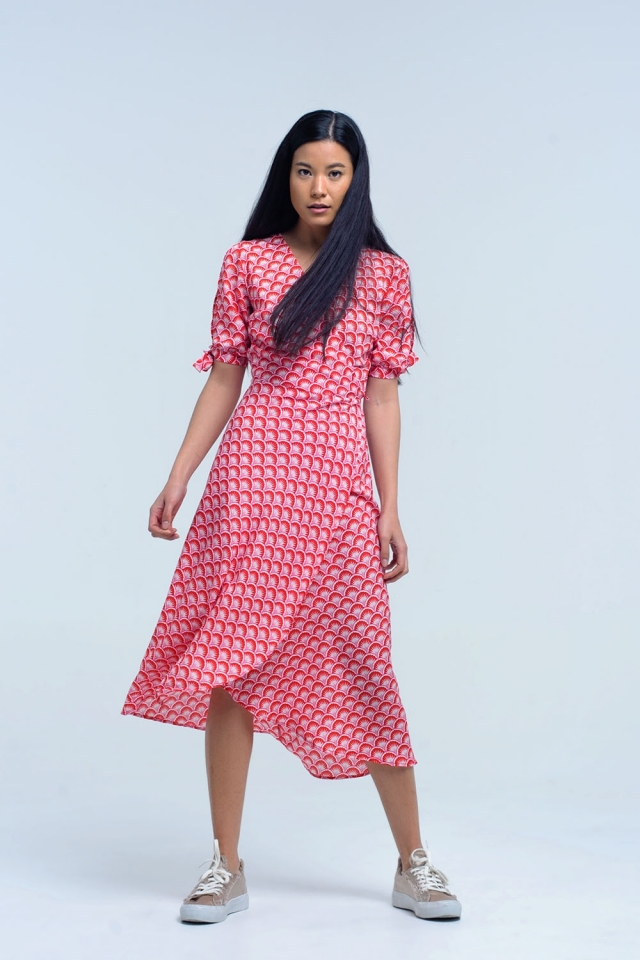 Asymmetrical red cross dress with geometric pattern