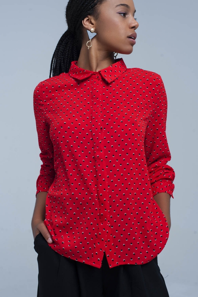 Red shirt with blue polka dots