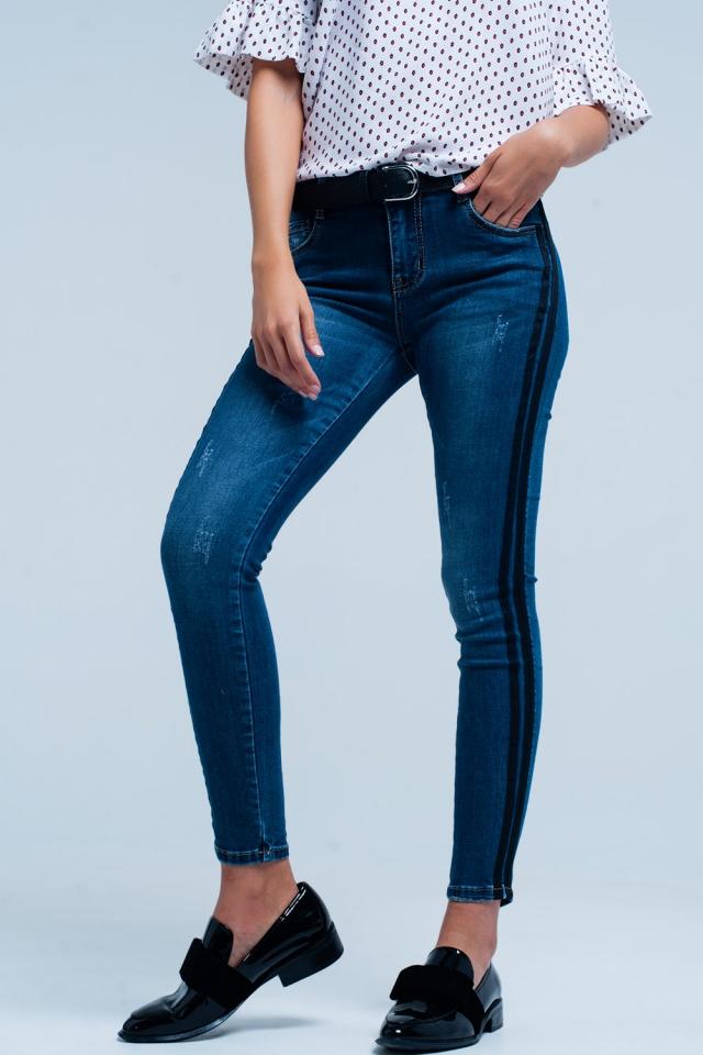 Blue skinny jeans with black side stripe