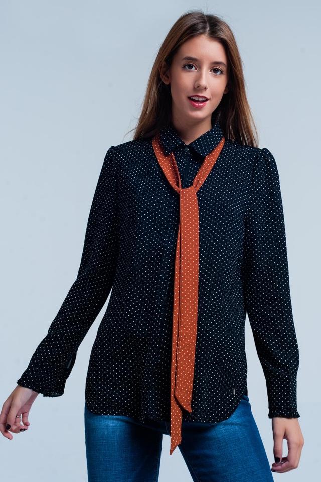 Black shirt with  polka dots and Orange tie