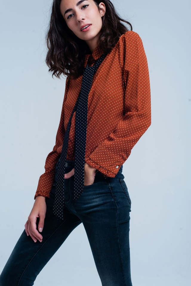 Orange shirt with  polka dots and black tie