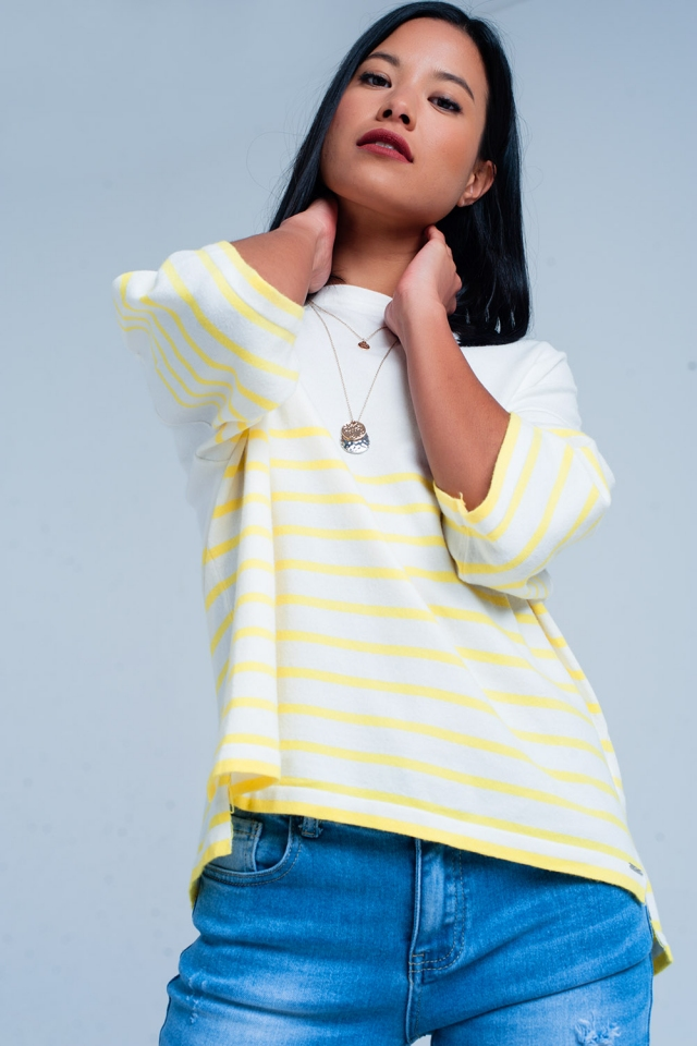 White sweater with yellow stripes