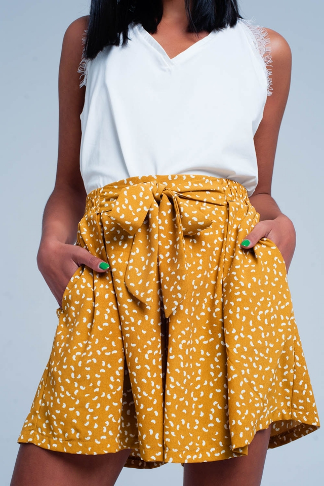 Mustard shorts with a white print
