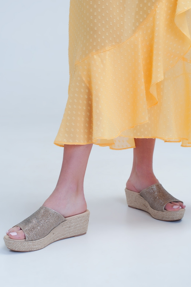 Wedges with one golden strap