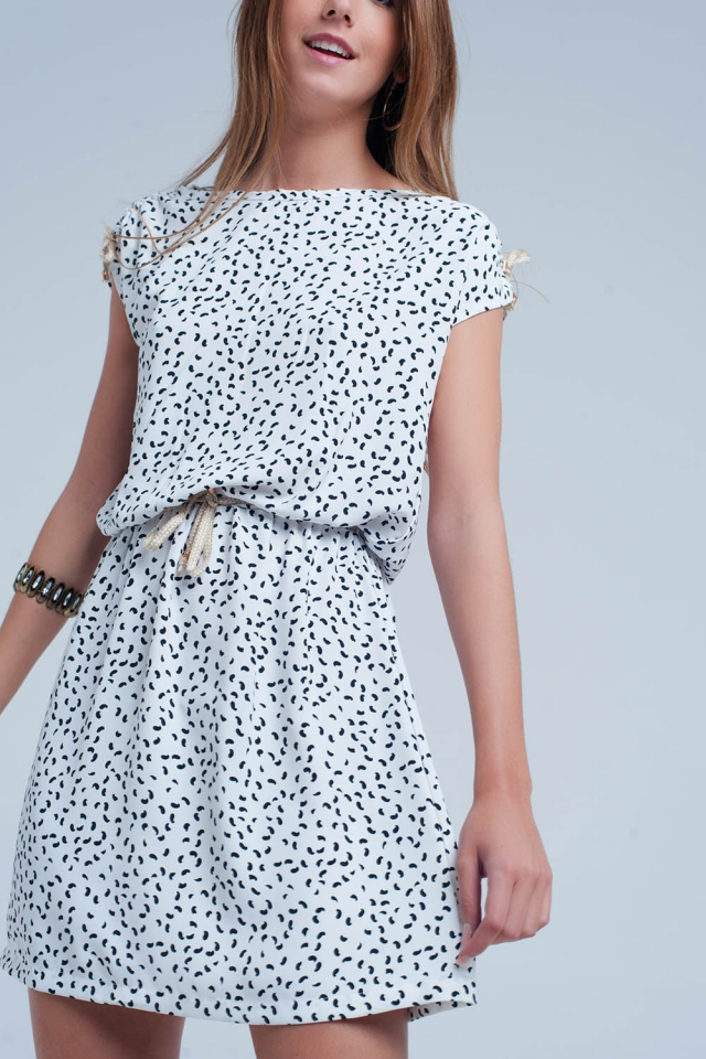 White dress with print and a belt
