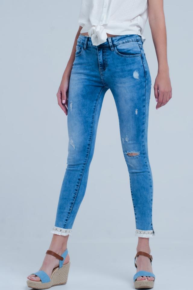 Skinny jeans with frayed hem