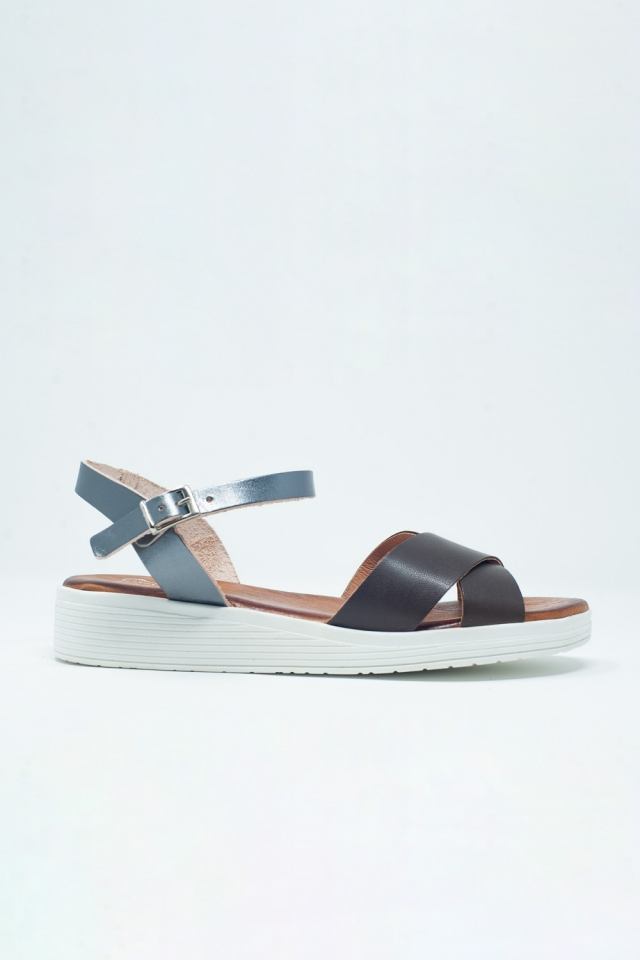 Brown flat sandals with crossed strap and ankle strap
