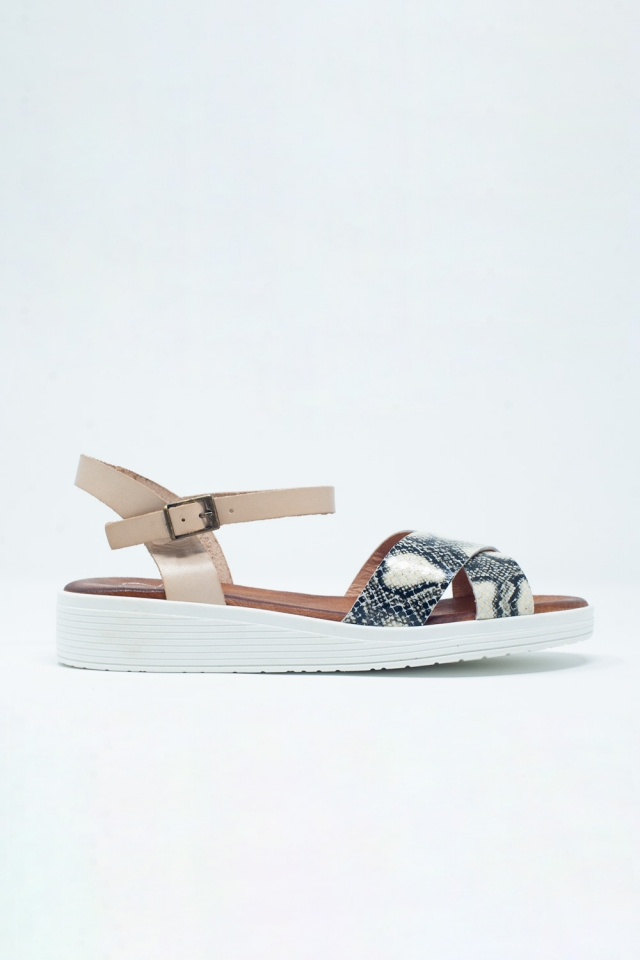 Beige flat sandals with crossed strap and ankle strap