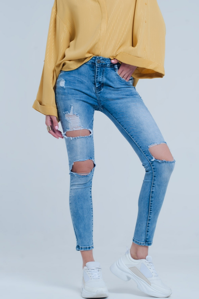 Light denim distressed skinny jeans