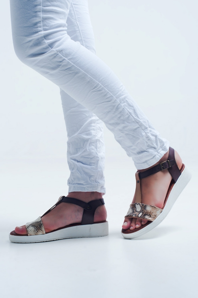 Beige sandals with snake print