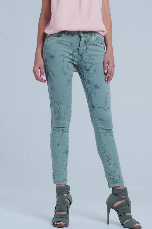 Green jeans with leaf print