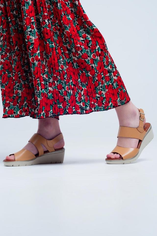 Beige coloured wedge sandals