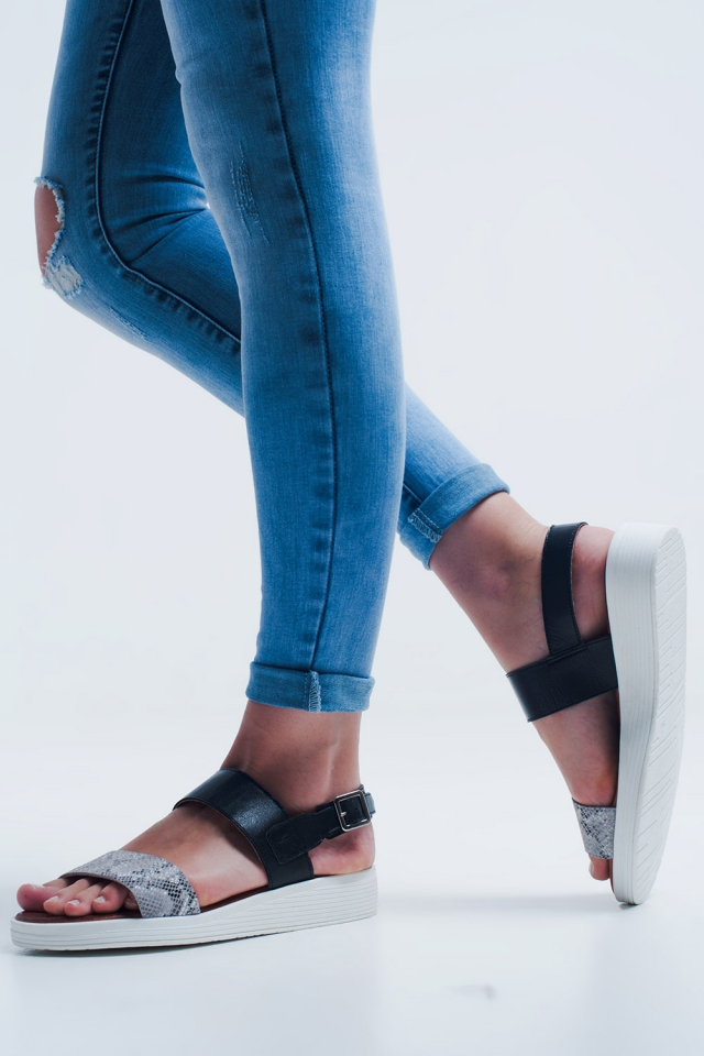 Black flat sandals with two straps