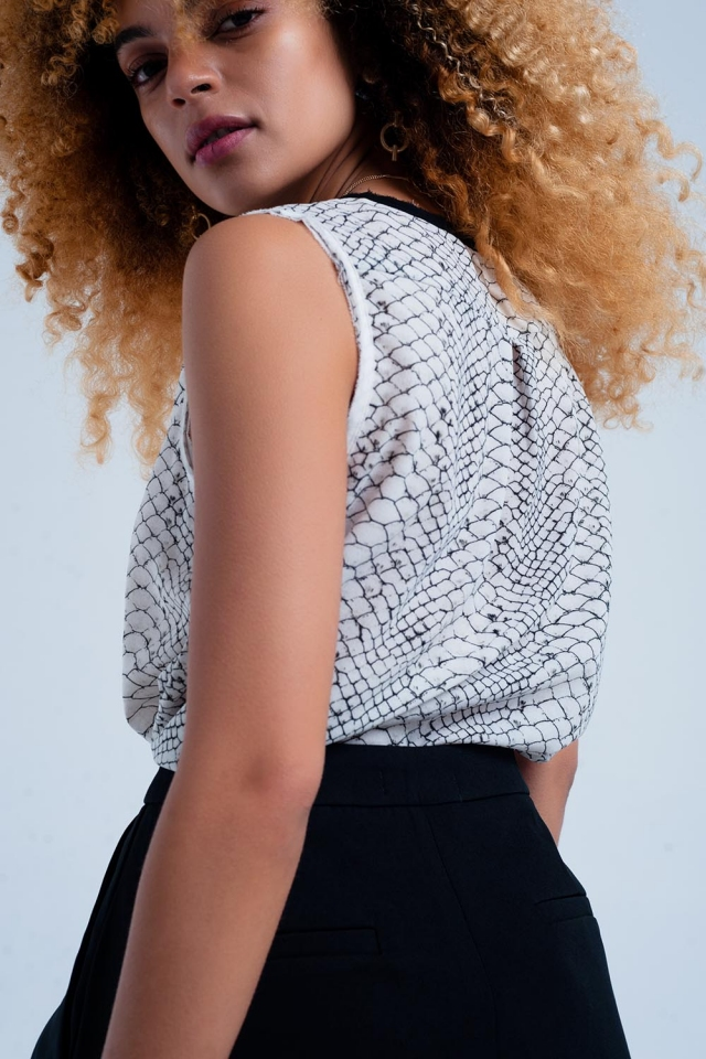 Sleeveless blouse with snake print