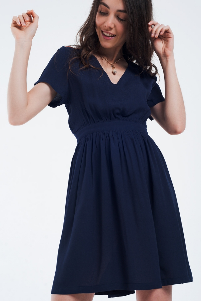 Mini navy dress with flight and detail on the shoulders