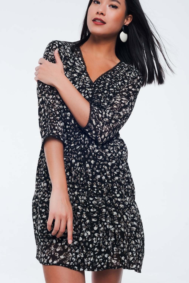 Black buttoned down dress with drop hem