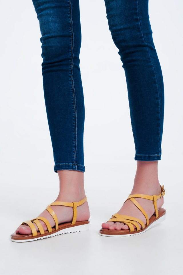 flat sandals with cross over straps and ankle ties in yellow
