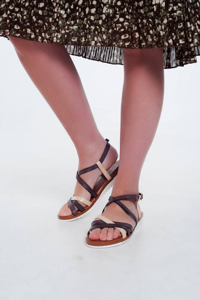 Flat sandals with cross over straps and ankle ties in brown