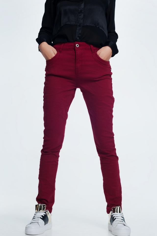 Drop crotch skinny jean in maroon