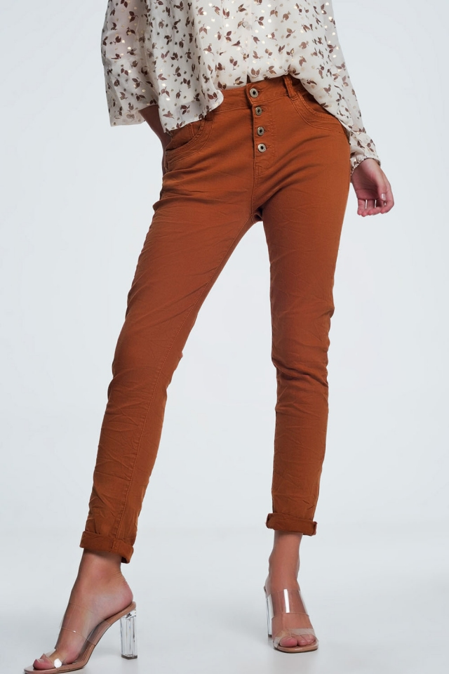 Orange jeans with button closure