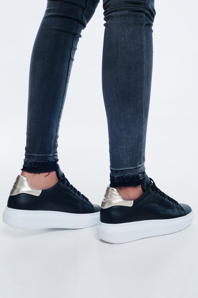 Black sneakers with golden detail