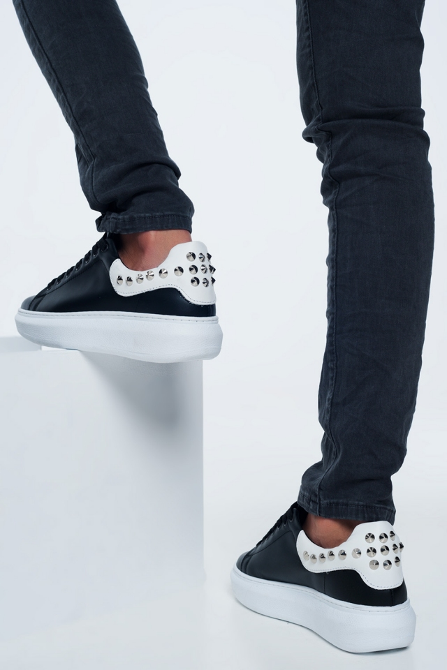 Black sneakers with studs