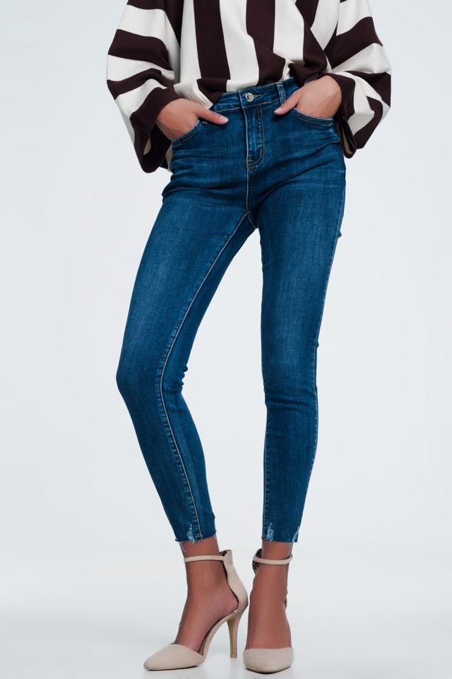 Skinny jeans in dark stone wash with raw hem detail