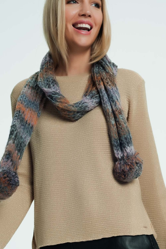 knitted scarve with pom pom details