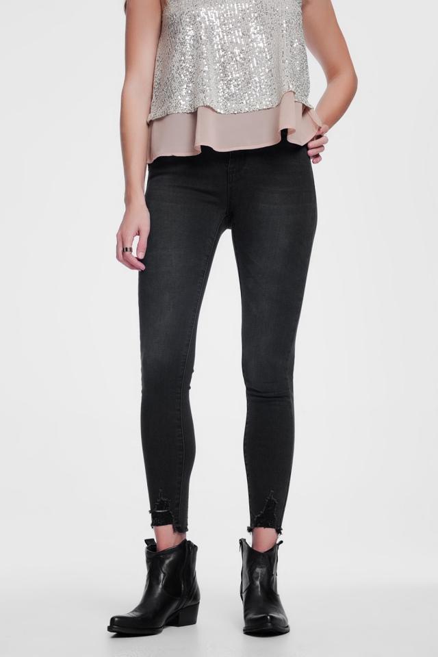 Distressed hem skinny black jeans
