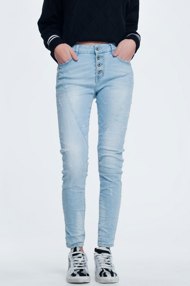 Jeans in light blue with exposed buttons fly