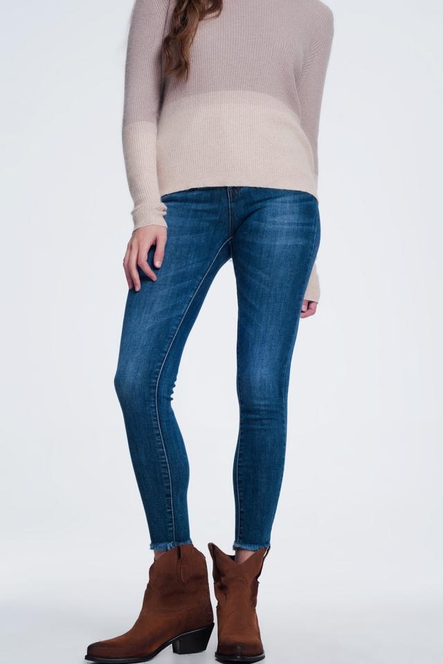 Dark wash jeans with raw hem