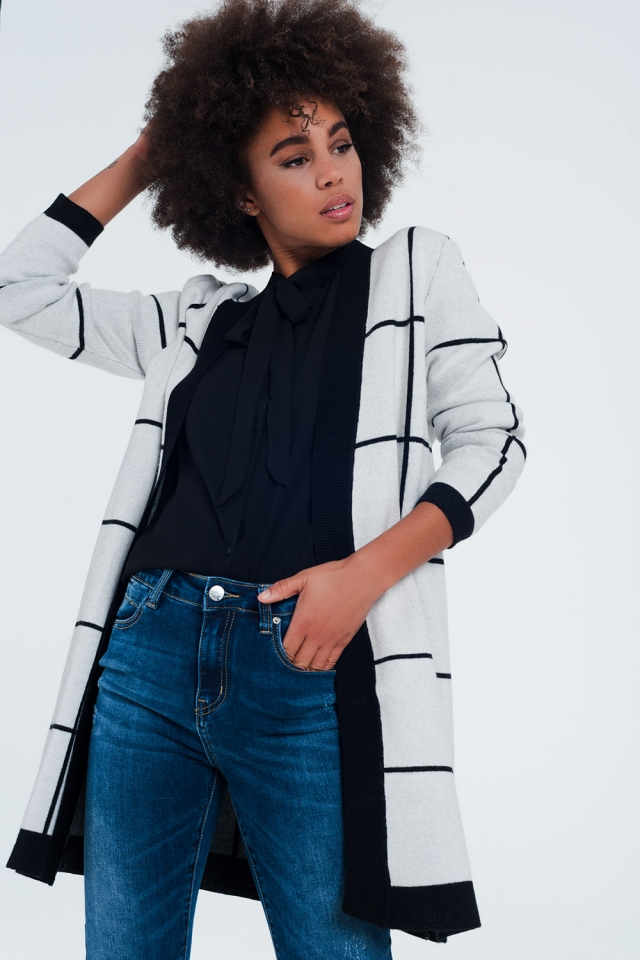 White striped cardigan with black details