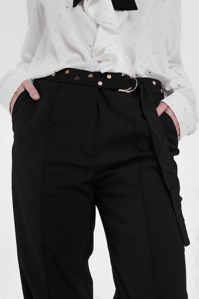 Black pants with wide legs and low hem