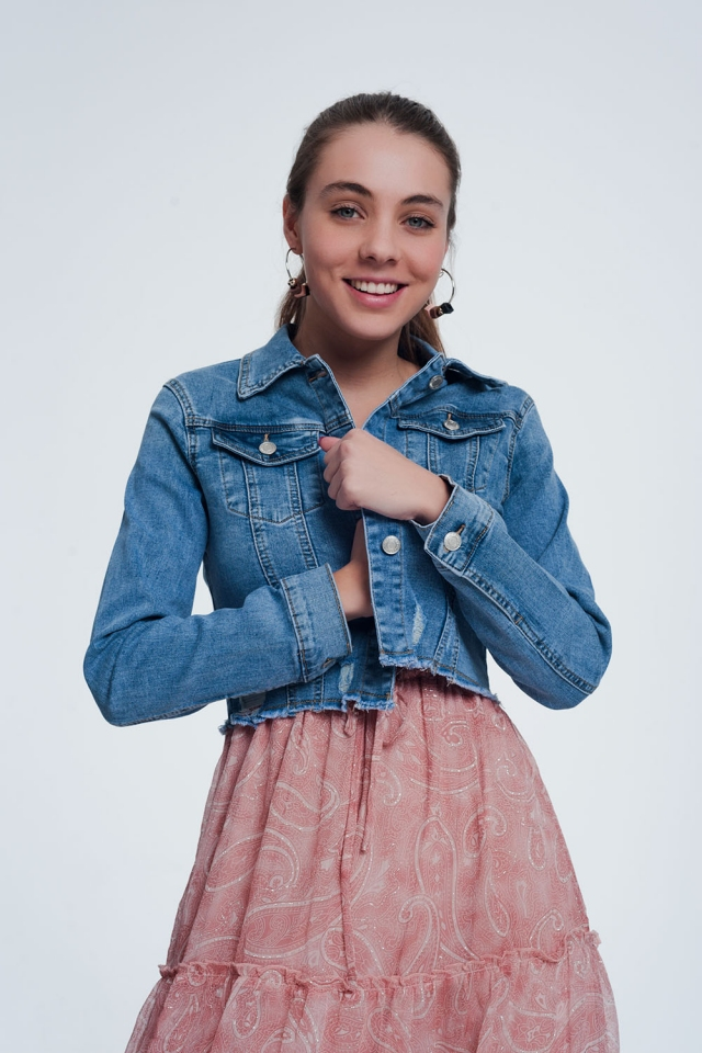Light denim cropped denim jacket with raw hem