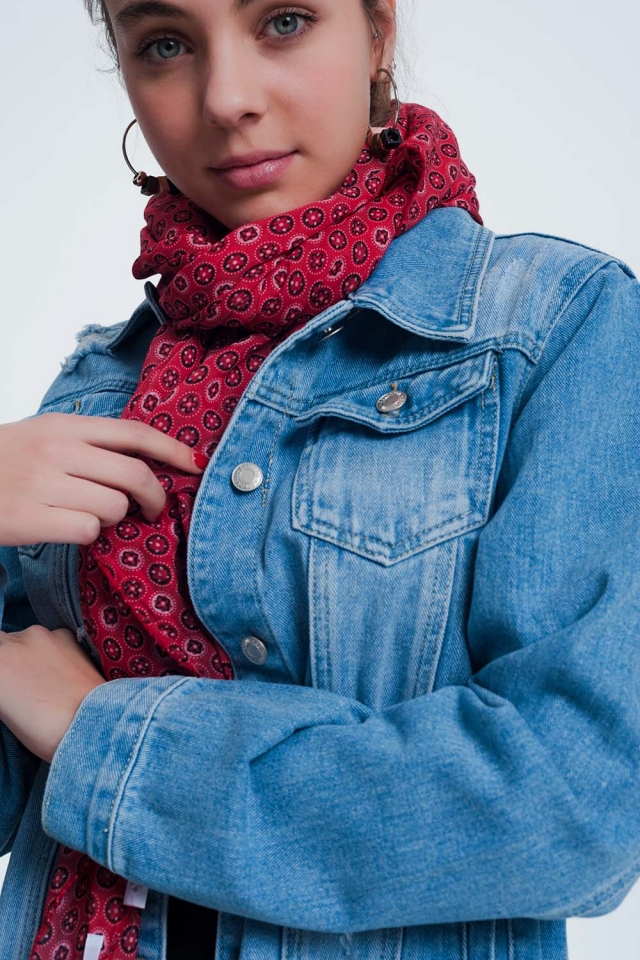 Red-colored scarf with a print of  circles