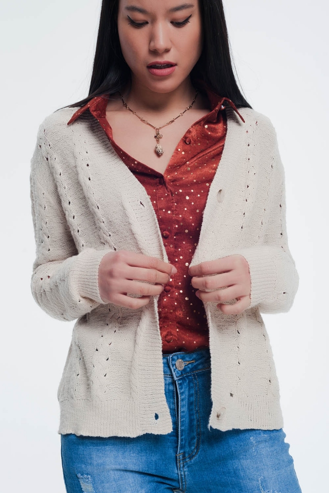 beige cardigan with knit detail and buttons
