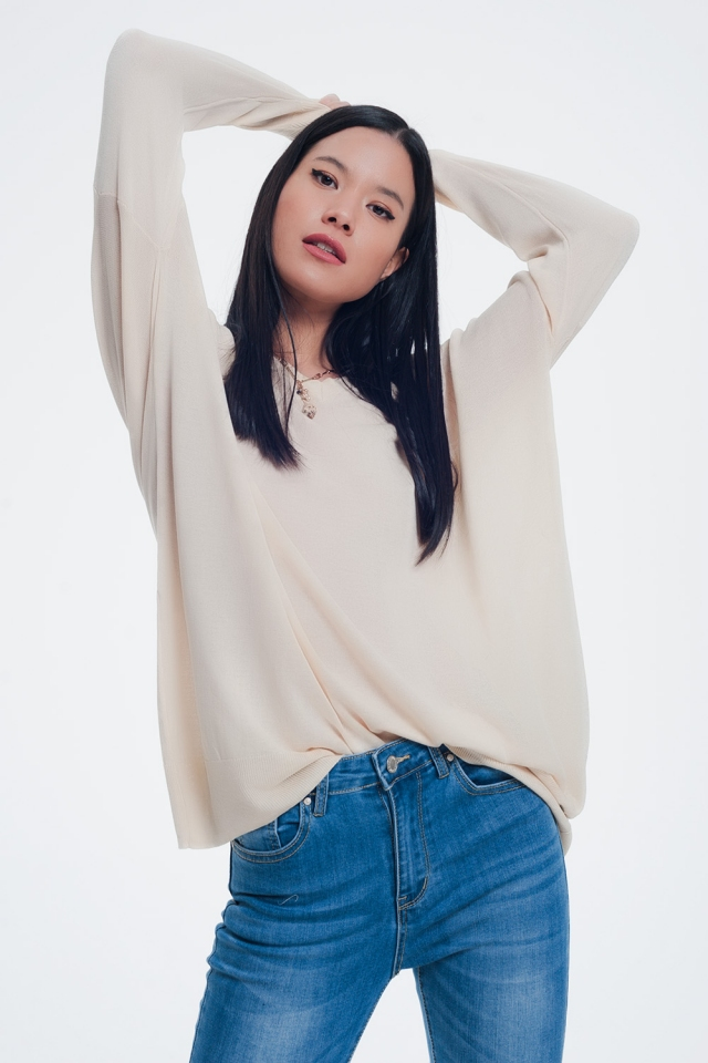 Beige sweater with v neck and long sleeves