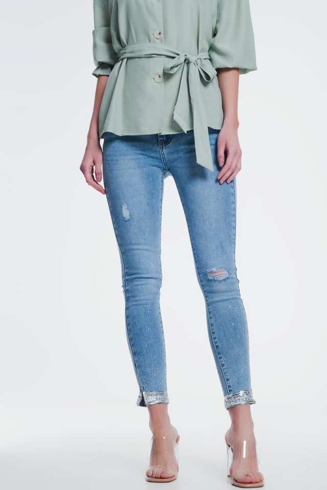 skinny jean with knee rips and sequin