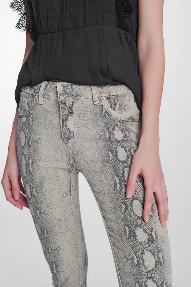 beige super skinny reversible trousers with snake print