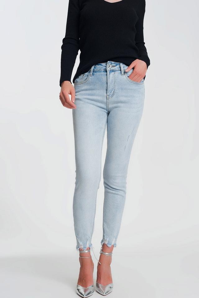 High rise raw hem skinny jeans in light denim