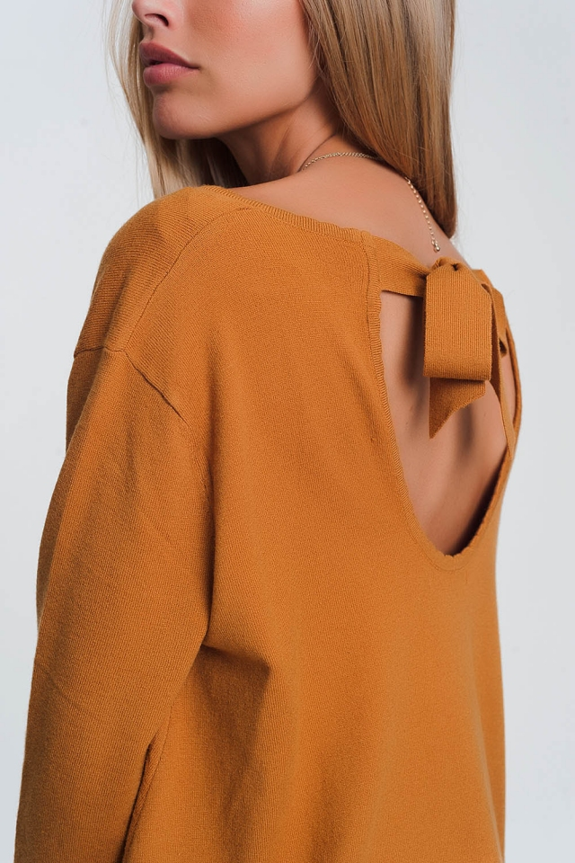Open tie back jumper with long sleeves and v neck in camel