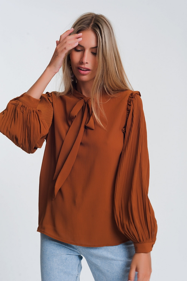 Top with volume sleeve and tie front detail in camel